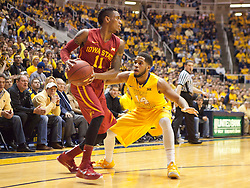 Iowa State Cyclones guard Monte Morris is guarded by West Virginia Mountaineers guard Gary Browne (14) during the first half at the WVU Coliseum.