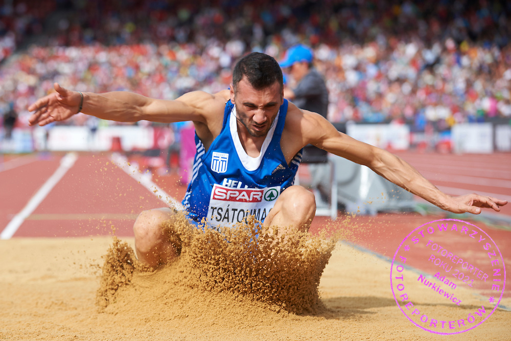 Louis Tsatoumas from Greece competes in men's long jump final during the Sixth Day of the European Athletics Championships Zurich 2014 at Letzigrund Stadium in Zurich, Switzerland.<br /> <br /> Switzerland, Zurich, August 17, 2014<br /> <br /> Picture also available in RAW (NEF) or TIFF format on special request.<br /> <br /> For editorial use only. Any commercial or promotional use requires permission.<br /> <br /> Photo by &copy; Adam Nurkiewicz / Mediasport