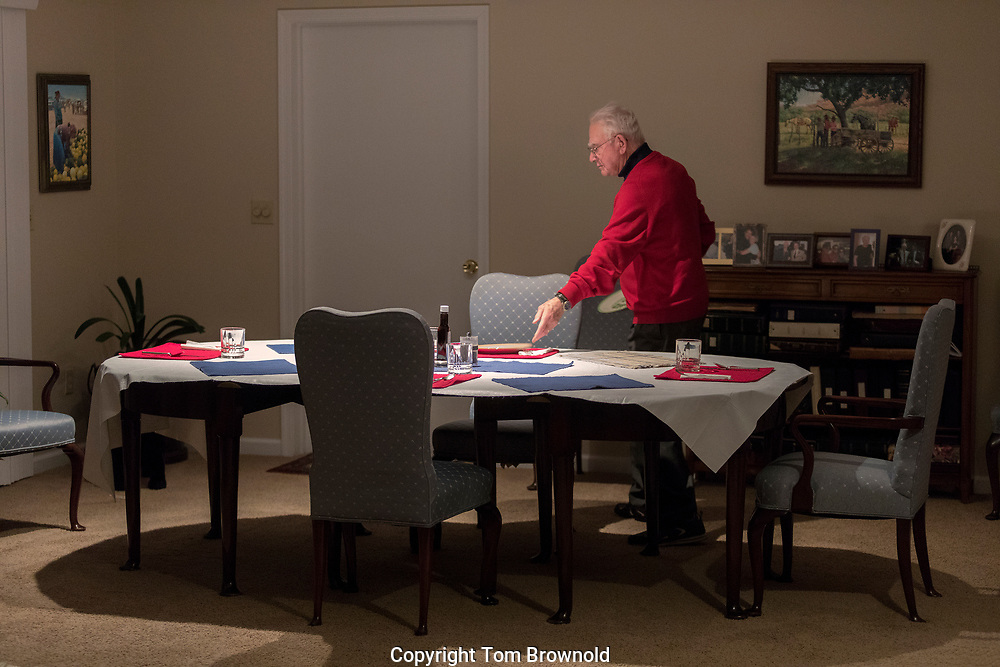 Living alone, doing as much as he can for himself, Dad prepares the dinner table for me, my brother and sister in law.