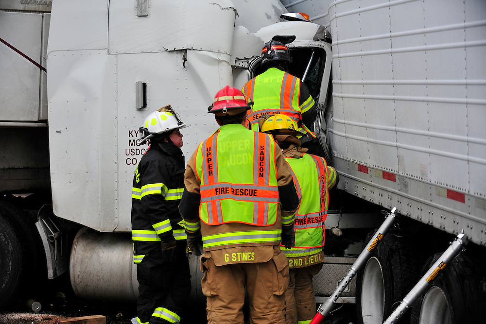 2/14/2013 Upper Saucon, PA Rescue crews work to extricate a truck driver pinned in his cab after a collision with another tractor trailer on Route 309 and Center Valley Parkway in Upper Saucon. The driver was trapped for several hours.
