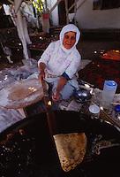 woman making guzleme in Turkey