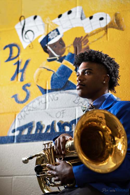 Khairy Jenkins is the author of the book, &quot;If My Horn Could Speak.&quot; It's this self-help book for kids his age. He'll graduate from Dudley and head to A&amp;T in the fall where he'll play in the band and work toward becoming a veterinarian.<br /> <br /> <br /> Photographed, Thursday, May 17, 2018, in Greensboro, N.C. JERRY WOLFORD and SCOTT MUTHERSBAUGH / Perfecta Visuals
