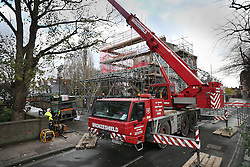 © Licensed to London News Pictures. 27/11/2015. London, UK. A large crane is parked outside a collapsed building in Barnes.  The Georgian townhouse collapsed as workmen were extending the property, which reportedly belongs to business man David Kassler . Singer Duffy was a previous occupant. Photo credit: Peter Macdiarmid/LNP