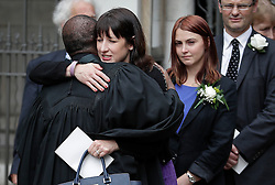 © Licensed to London News Pictures. 20/06/2016. London, UK. RACHEL REEVES MP being embraced by REVEREND ROSE HUDSON-WILKIN as she leaves St Margaret's Church, Westminster Abbey after taking part in a Service of Prayer and Remembrance to commemorate Jo Cox MP, who was killed in her constituency on June 16, 2016. Photo credit: Peter Macdiarmid/LNP