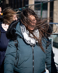 © Licensed to London News Pictures. 14/03/2019.London, UK.  Changeable weather sweeps up river effecting commuters and tourists, as they are hit by rain, high winds and blinding sun in the space of one hour. Photo credit: Guilhem Baker/LNP