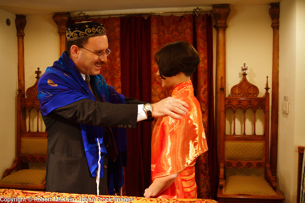 IDAHO. Boise. Rabbi blessing Asian Jewish girl on the bimah at her Bat Mitzvah. December 2008. #pa080659 MR