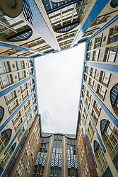 View of historic ornate buildings at Hackesche Hofe (courtyard) at Hackescher Markt in Mitte Berlin, Germany