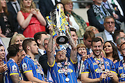 Rhys Murphy lifting the trophy following the Sky Bet League 2 play off final match between AFC Wimbledon and Plymouth Argyle at Wembley Stadium, London, England on 30 May 2016.