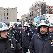 Police wait for the Occupy Brooklyn March over the Williamsburg Bridge, New York, USA. 1st May 2012. Photo Tim Clayton