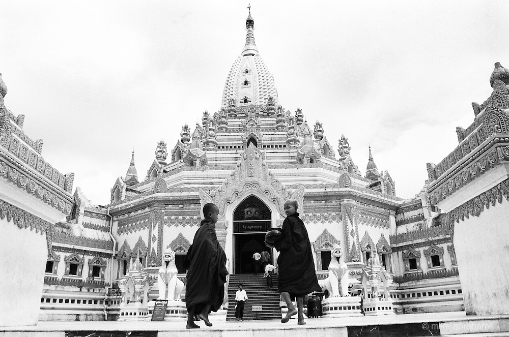 Young monks walk up the steps of their Pagoda. Rangoon, Burma 1997