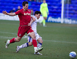 BIRKENHEAD, ENGLAND - Saturday, February 18, 2012: Tranmere Rovers' David Buchanan in action against Charlton Athletic's Yann Kermorgant during the Football League One match at Prenton Park. (Pic by Vegard Grott/Propaganda)