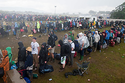 Campers queue for their buses, to head home after the weekend..T in the Park on Monday 11th July 2011. T in the Park 2011 music festival takes place from 7-10th July 2011 in Balado, Fife, Scotland..©Pic : Michael Schofield.