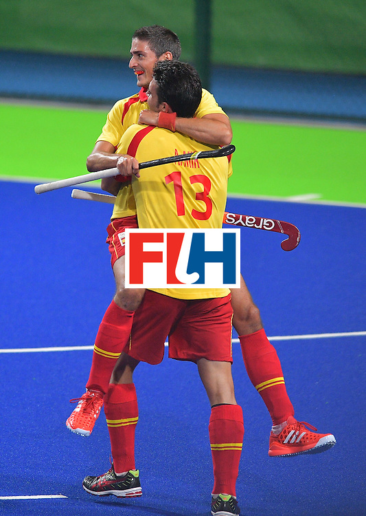 Spain's Xavi Lleonart (back) celebrates scoring a goal with teammate Andres Mir during the men's field hockey Spain vs Brazil match of the Rio 2016 Olympics Games at the Olympic Hockey Centre in Rio de Janeiro on August, 6 2016. / AFP / Carl DE SOUZA        (Photo credit should read CARL DE SOUZA/AFP/Getty Images)