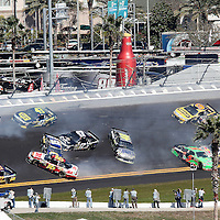 NASCAR Sprint Cup Series drivers Michael Waltrip (15), Andy Lally (71), Joe Nemechek (87) Greg Biffle (16), David Reutimann (00), JImmie Johnson (48), Mark Martin (5) and Jeff Gordon (24) are involved in a multi car crash during the Daytona 500 at Daytona International Speedway on February 20, 2011 in Daytona Beach, Florida. (AP Photo/Alex Menendez)