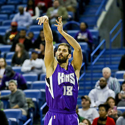 Jan 28, 2016; New Orleans, LA, USA; Sacramento Kings forward Omri Casspi (18) shoots against the New Orleans Pelicans during the first quarter of a game at the Smoothie King Center. Mandatory Credit: Derick E. Hingle-USA TODAY Sports
