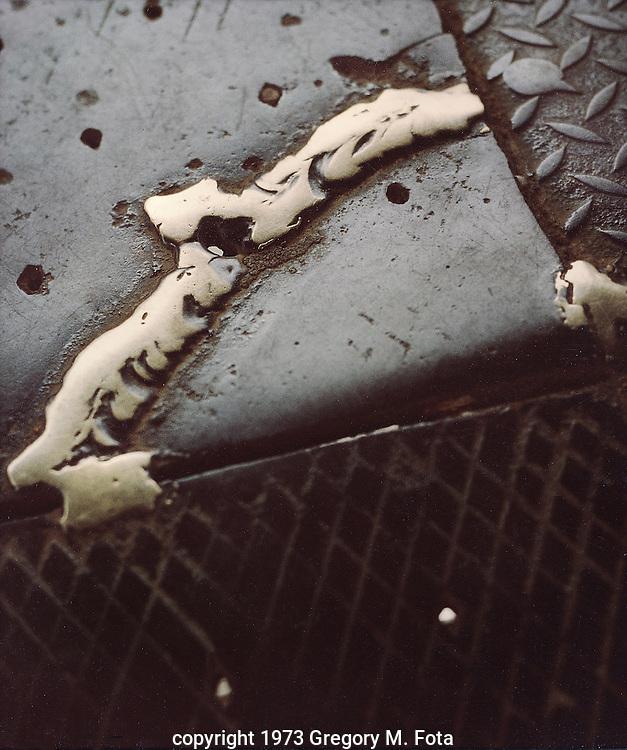 RADNOR WELD -Brass weld on iron plate, tower in  Radnor,PA. c. 1973