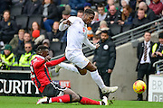 Milton Keynes Dons striker Kieran Agard (14) rides a tackle during the EFL Sky Bet League 1 match between Milton Keynes Dons and Shrewsbury Town at stadium:mk, Milton Keynes, England on 25 February 2017. Photo by Dennis Goodwin.