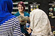 Kate Burton, center, a first year Theater MFA student explains her process for building a dinosaur puppet  during the Ohio University Student Expo on Thursday, April 10, 2015. The upper took Burton approximately 25 hours to build.   Photo by Ohio University  /  Rob Hardin