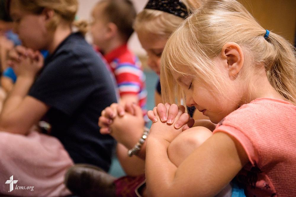 Children pray during worship on Sunday, Sept. 24, 2017, at Faith Lutheran Church, York, Neb. LCMS Communications/Erik M. Lunsford