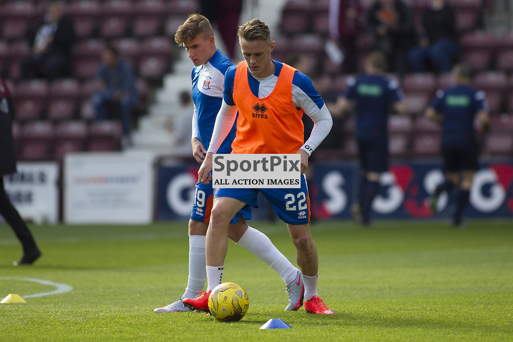 Former Hearts player Kevin McHattie of Kilmarnock warms up before the Ladbrokes Scottish Premiership match between Heart of Midlothian FC and Kilmarnock FC at Tynecastle Stadium on October 4, 2015 in Edinburgh, Scotland. Photo by Jonathan Faulds/SportPix