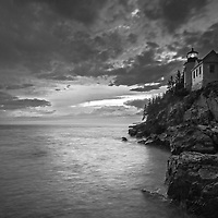 Black and White New England photography of the iconic Bass Harbor Head Light located on Mount Desert Island within Maine Acadia National Park on the southeast corner of MDI. The lighthouse towers over the swirling Atlantic Ocean and seacoast, marking the entrance to Bass Harbor and Blue Hill Bay. It is one of the most iconic scenery of Acadia NP as Bass Harbor Light is dramatically located on the edge of rugged cliffs.<br /> <br /> This New England B&amp;W lighthouse fine art photography image is available as museum quality photography prints, canvas prints, acrylic prints or metal prints. Fine art prints may be framed and matted to the individual liking and decorating needs:<br /> <br /> https://juergen-roth.pixels.com/featured/maine-bass-harbor-head-light-juergen-roth.html<br /> <br /> Good light and happy photo making!<br /> <br /> My best,<br /> <br /> Juergen<br /> Prints: http://www.rothgalleries.com<br /> Photo Blog: http://whereintheworldisjuergen.blogspot.com<br /> Instagram: https://www.instagram.com/rothgalleries<br /> Twitter: https://twitter.com/naturefineart<br /> Facebook: https://www.facebook.com/naturefineart