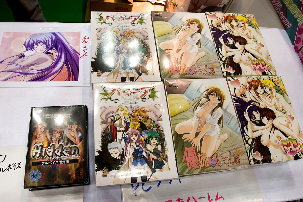 """Stall sellingg pictures and posters of anime, manga and computer-games characters. TOKYO COMIC MARKET """"COMIKET"""" the biggest comic market in Japan. Independent designers come to sell their comics, there is anime, manga, cosplay, toys, posters etc. At """"Tokyo Big Sight"""" exhibition center."""