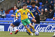 Oldham - Saturday February 26th, 2010 :  Wes Hoolahan of Norwich and Jason Price of Oldham in action during the Coca Cola League One match at Boundary Park, Oldham. (Pic by Paul Chesterton/Focus Images)..
