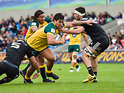 Australia prop Tyrel Lomax drives through New Zealand second-row Hamish Dalzell and flanker Luke Jacobson during the World Rugby U20 Championship 5rd Place play-off  match Australia U20 -V- New Zealand U20 at The AJ Bell Stadium, Salford, Greater Manchester, England on Saturday, June  25  2016.(Steve Flynn/Image of Sport)