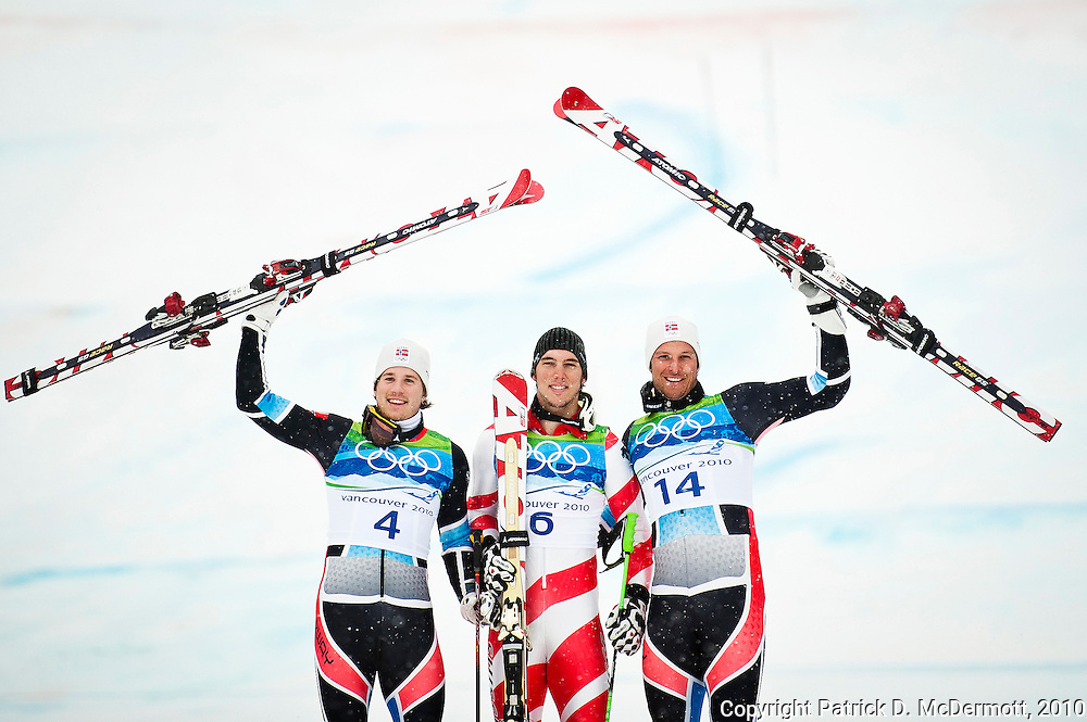 (L-R) Silver medalist Kjetil Jansrud of Norway, gold medalist Carlo Janka of Switzerland and bronze medalist Aksel Lund Svindal of Norway celebrate after the Alpine Skiing Men's Giant Slalom on day 12 of the Vancouver 2010 Winter Olympics at Whistler Creekside on February 23, 2010 in Whistler, Canada.