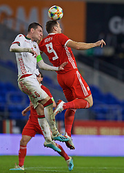 CARDIFF, WALES - Monday, September 9, 2019: Wales' Sam Vokes (R) challenges for a header with Belarus' Siarhei Palitsevich during the International Friendly match between Wales and Belarus at the Cardiff City Stadium. (Pic by David Rawcliffe/Propaganda)