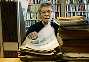 Elsie Eiler talks to a visitor in the 5,000 book library as she looks through old newspapers in the village of Monowi, Nebraska April 28, 2011. Eiler is the person living in Monowi making it the only incorporated town, village or city in the United States with only one resident.  The library was the dream of her late husband Rudy a devoted reader. REUTERS/Rick Wilking (UNITED STATES)