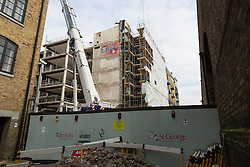 © Licensed to London News Pictures. 17/02/2016. London, UK. Construction and refurbishment of affordable housing at the London Dock site (formerly Times House). London Dock is a residential mixed-use development on the 15 acre site of the former News International (now News UK) which has been fully demolished except for the listed Pennington Street warehouse and Times House, which is being refurbished . When fully completed, 486 of the 1,800 new homes will be affordable, with 274 affordable and social rented homes and 212 homes for first time buyers. Photo credit : Vickie Flores/LNP
