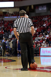 26 January 2016: John Higgins secures the ball with his foot during a time out as he speaks with Hal Lusk during the Illinois State Redbirds v Drake Bulldogs at Redbird Arena in Normal Illinois (Photo by Alan Look)