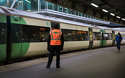 © Licensed to London News Pictures. 19/12/2016. London, UK. A Southern Rail train pulls away at Clapham Junction. Some Southern Rail services are running today as ASLEF union drivers started a two day strike in a dispute over driver-only operated trains. Photo credit: Peter Macdiarmid/LNP