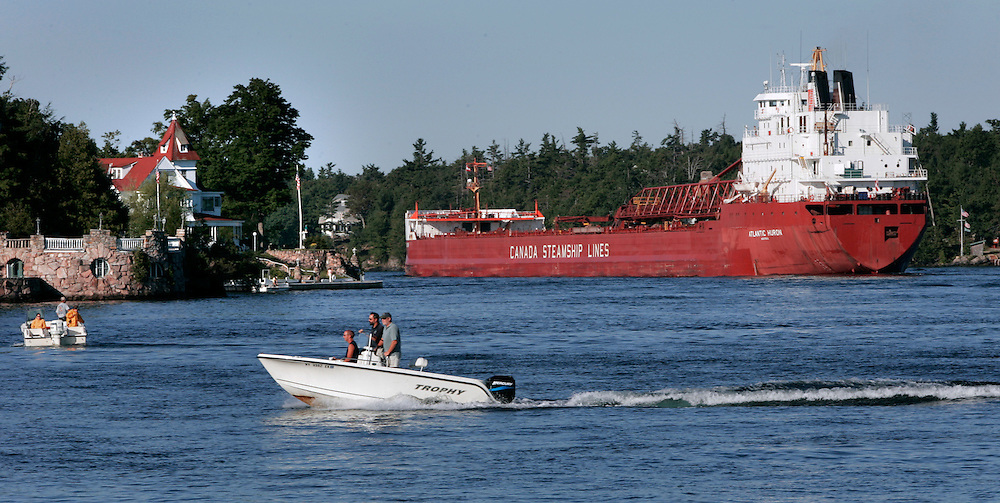 St. Lawrence, nws, lynn, 17.-The Atlantic Huron sails through the 1000 Islands portion of the St. Lawrence River on its way upbound toward Lake Ontario Sunday August 6, 2005.  Photographed from Alexandria Bay New York ships really thread a needle through this area.