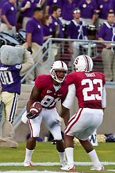 September 26, 2009; Stanford, CA, USA; Stanford Cardinal wide receiver Chris Owusu (81) celebrates with safety Austin Yancy (23) after returning the opening kick off for a touchdown against the Washington Huskies in the first quarter at Stanford Stadium.
