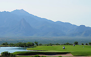 The Santa Rita Mountains of the Coronado National Forest in the Sonoran Desert serve as a backdrop for the Canoa Ranch Golf Club in Green Valley, Arizona, USA.