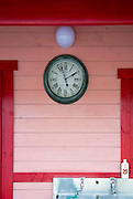 Photo shows the clock hanging on the exterior of one of the rainbow-colored cabins at The Cicada Fort that stands on the tsunami-ravaged land of Takata district in Rikuzentakata, Iwate Prefecture Japan on 08 Oct. , 2013. PHOTO: ROB GILHOOLY