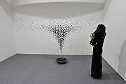 HONG KONG - MARCH 13:  A visitor looks at art piece 'An Aggregation' by Seonghi Bahk in art fair Art Central on its preview day on March 13, 2015 in Hong Kong, Hong Kong.  (Photo by Lucas Schifres/Getty Images)