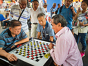 26 DECEMBER 2015 - SINGAPORE, SINGAPORE: Men play checkers and board games in a park in Singapore's Chinatown.      PHOTO BY JACK KURTZ