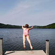 Lily Finn, 5, of Middlebury, takes a giant leap off of a dock at Lake Morey while swimming with her parents in Fairlee on June 11, 2012.  Lily was visiting family in the area with her parents.