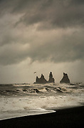 Reynisfjara black-sand beach found on the South Coast of Iceland, beside the small fishing village of Vík í Mýrdal.