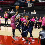 10 February 2018: The San Diego State Aztecs women's basketball team hosts Nevada on Play4Kay day at Viejas Arena. San Diego State Aztecs guard McKynzie Fort (15) attempts a jump shot just outside the paint over Nevada Wolf Pack guard Camariah King (24) in the first half. <br /> More game action at www.sdsuaztecphotos.com