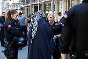 Frankfurt am Main | 17 July 2014<br /> <br /> Solidarit&auml;tsdemo f&uuml;r Israel, f&uuml;r Frieden und f&uuml;r das Ende der Angriffe der Hamas auf dem Opernplatz vor der Alten Oper in Frankfurt am Main, hier: Aktivisten f&uuml;r die Sache der Pal&auml;stinenser haben versucht, den Opernplatz zu erreichen, um die Demo zu st&ouml;ren, werden aber von der Polizei aufgehalten und durchsucht. <br /> <br /> &copy; peter-juelich.com
