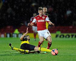 Bristol City's Joe Bryan is tackled by Watford's Gabriele Angella - Photo mandatory by-line: Dougie Allward/JMP - Tel: Mobile: 07966 386802 14/01/2014 - SPORT - FOOTBALL - Vicarage Road - Watford - Watford v Bristol City - FA Cup - Third Round - replay