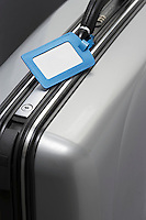 Suitcase with blank tag close-up