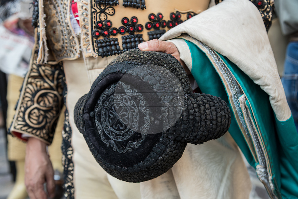 A Mexican Matador holds his hat and cape as he waits to enter the ring at the Plaza de Toros in San Miguel de Allende, Mexico.
