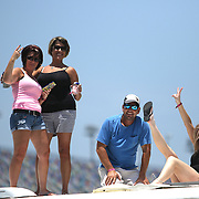 Race fans pose atop their RV in the infield camping area prior to the 57th Annual NASCAR Coke Zero 400 stock car race at Daytona International Speedway on Sunday, July 5, 2015 in Daytona Beach, Florida.  (AP Photo/Alex Menendez)