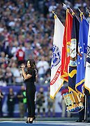 American actress and singer-songwriter Idina Menzel sings the National Anthem before the Seattle Seahawks NFL Super Bowl XLIX football game against the New England Patriots on Sunday, Feb. 1, 2015 in Glendale, Ariz. The Patriots won the game 28-24. ©Paul Anthony Spinelli