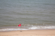 Red flag on beach Southwold, Suffolk, England